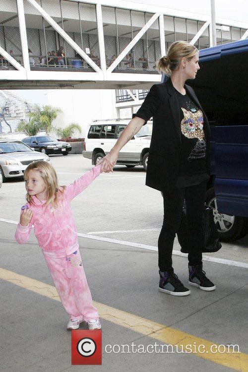 Heidi Klum is pictured with daughter Leni Klum...