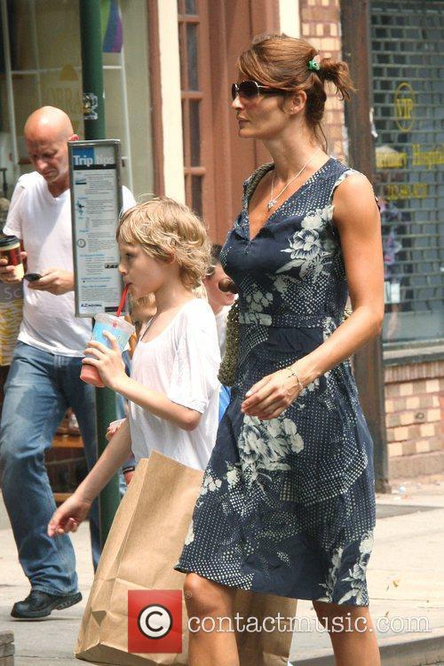 Helena Christensen out walking with her children in...