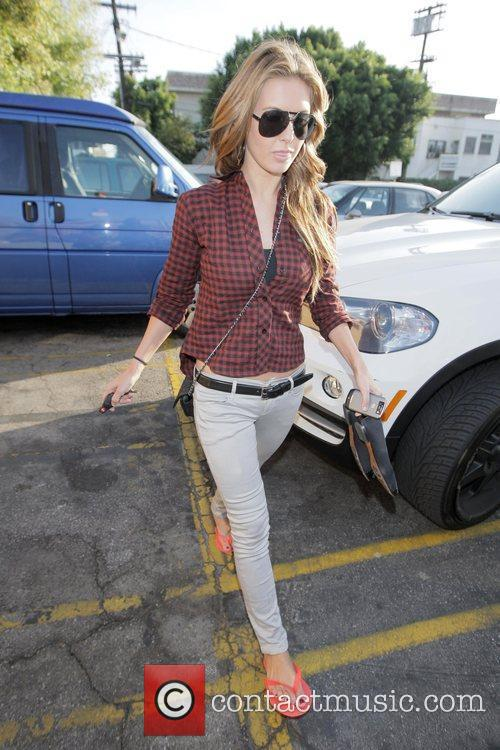 Arrives at a nail spa in West Hollywood