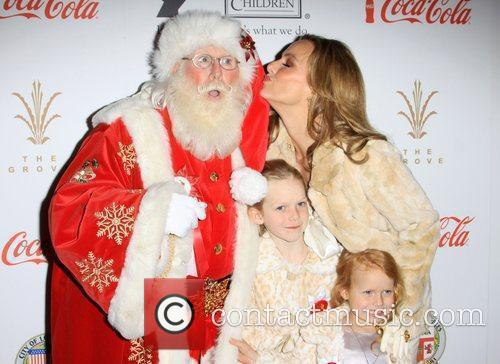 Melora Hardin with her daughters and Santa Claus...