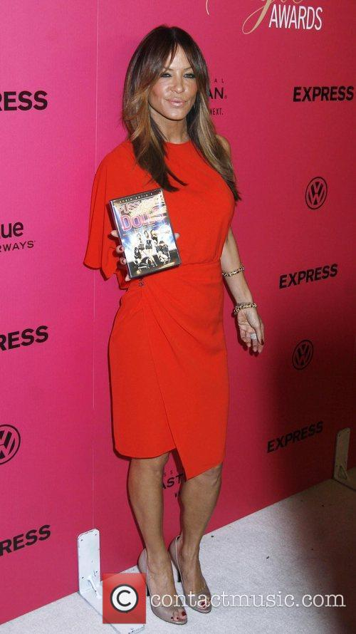 Robin Antin holding a copy of the Pussycat...