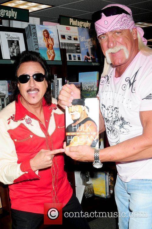 Fan and Hulk Hogan Hulk Hogan signs copies...