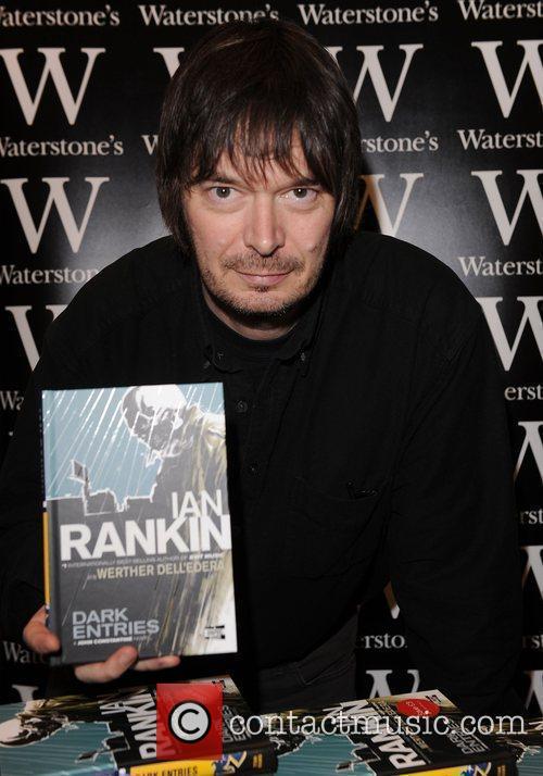Ian Rankin  signing copies of his book...