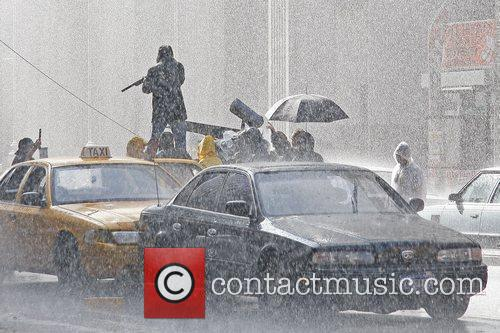 Artificial rain is created for a scene on...