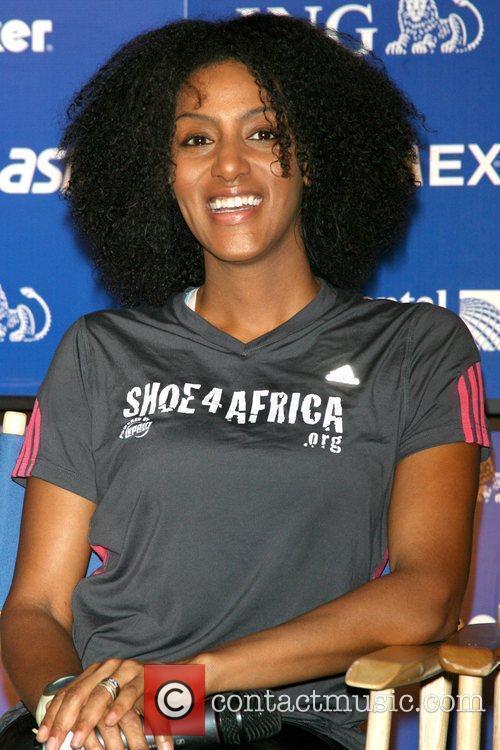 Sarah Jones Shoe4Africa running team press conference during...