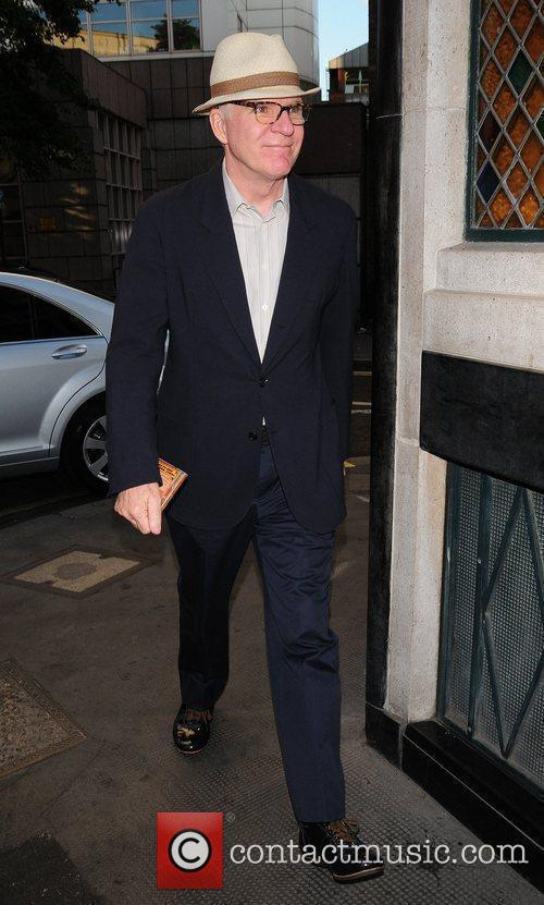 Steve Martin outside the Ivy restaurant carrying a...