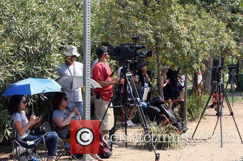 Atmosphere Media crews converge outside the Encino residence...