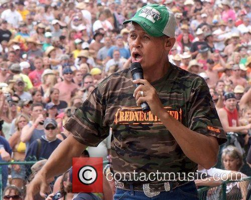 Country Music Singer Neal Mccoy Sings From Atop A Speaker Tower 1