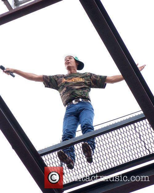 Country music singer Neal McCoy sings from atop...