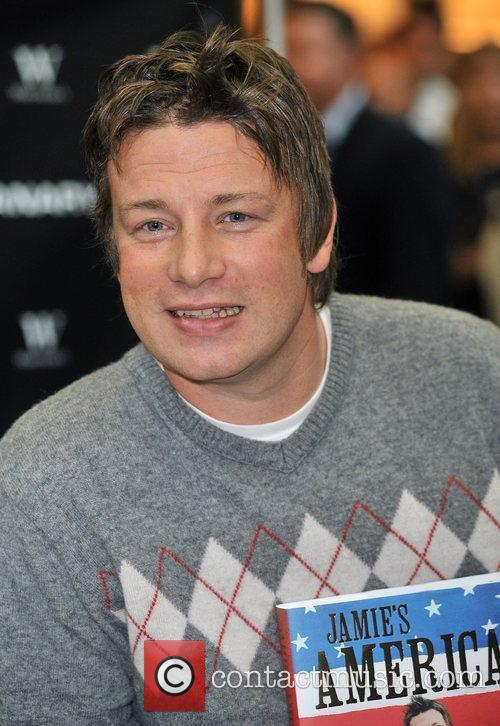 Signing copies of his new book 'Jamie's America'...