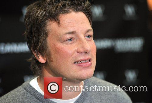 Jamie Oliver signing copies of his new book...