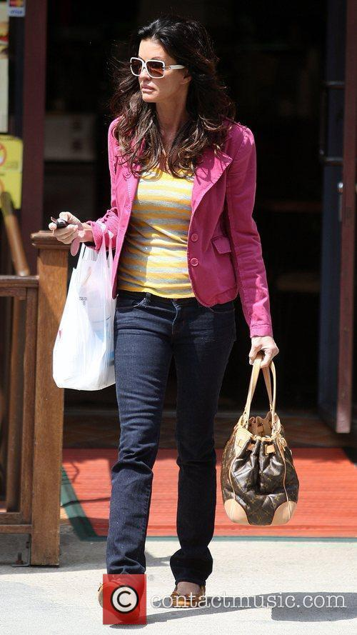 Janice Dickinson picks up lunch from a deli...