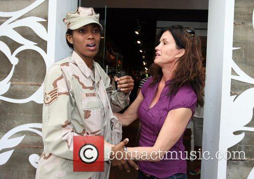 Janice Dickinson shows her appreciation for the armed...