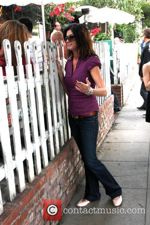 Janice Dickinson stops outside the Ivy restaurant to...