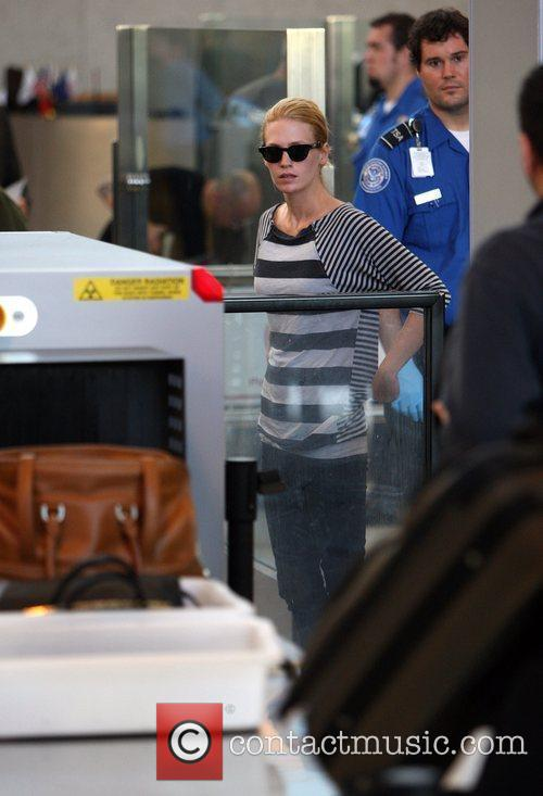 January Jones goes through security at LAX airport...