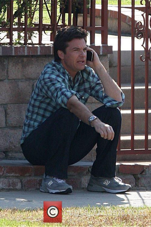 Seen talking on the phone during the filming...