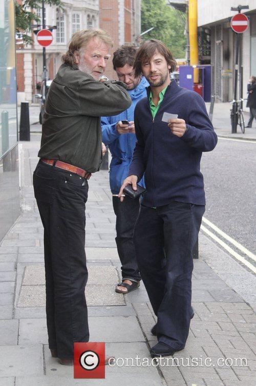 Smoking a cigarette as he leaves Nobu restaurant