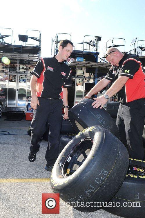 Jeff Gordon's crew work on his car at...