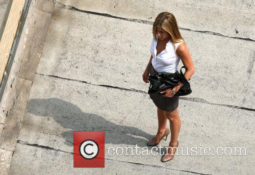Jennifer Aniston filming a rooftop scene where her...