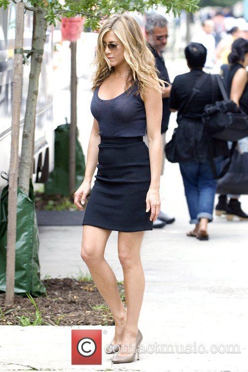 Jennifer Aniston walking to her makeup trailer during...