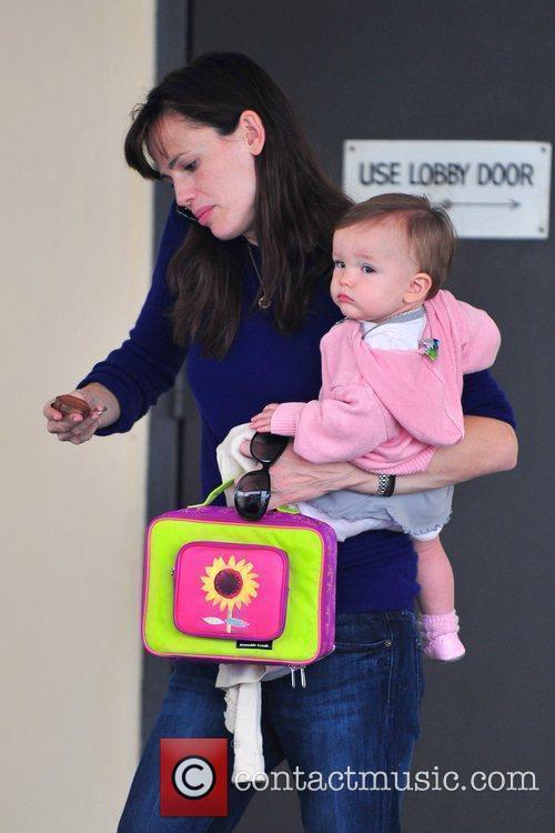 Jennifer Garner holds her daughter Seraphina Affleck as...