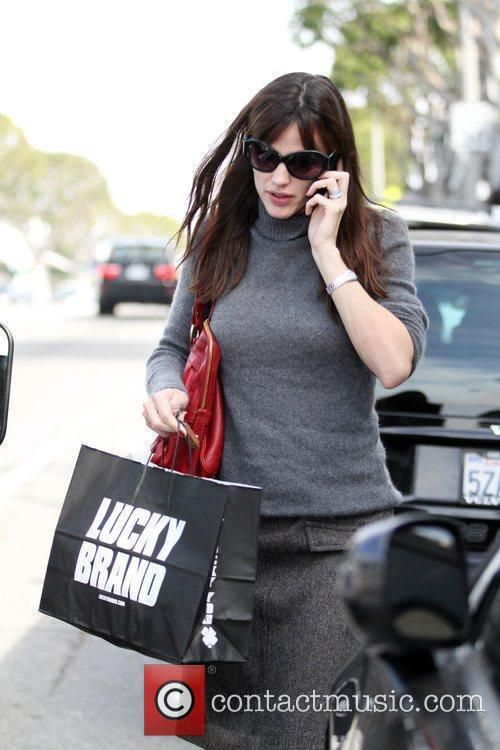 Leaving the Lucky Brand store after making a...