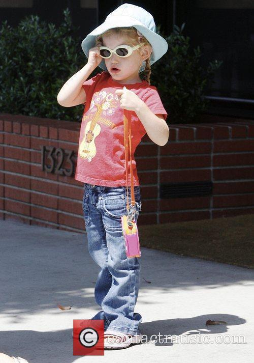 Violet Affleck, fixing her sunglasses, spends the day...