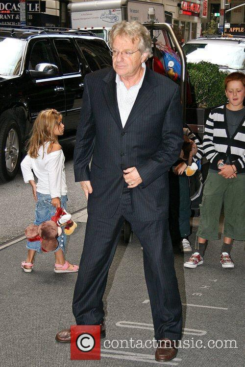 Jerry Springer poses for photographs as he arrives...