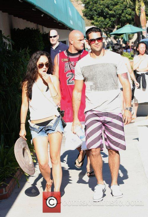 With a girl and his bodyguard, at Malibu...