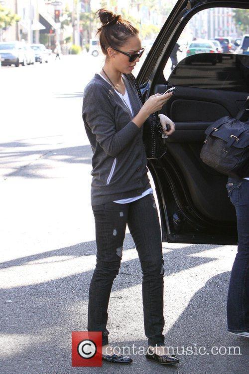 Jessica Alba making a phone call while walking...