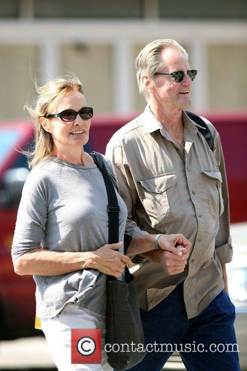 Jessica Lange and Sam Shepard walk arm-in-arm through...