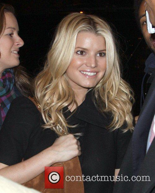 Singer Jessica Simpson with her personal assistant outside...