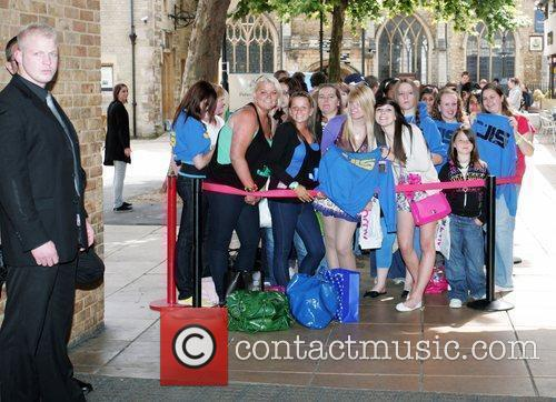 Fans Wait Eagerly Outside An Hmv Store In Peterborough Where Boyband Jls Will Be Meeting Fans 2