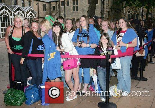 Fans Wait Eagerly Outside An Hmv Store In Peterborough Where Boyband Jls Will Be Meeting Fans 6