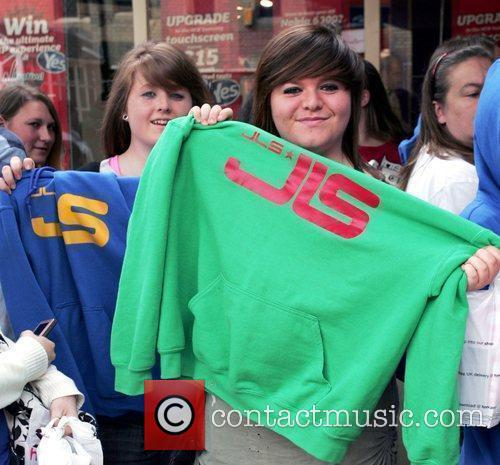 Fans Wait Eagerly Outside An Hmv Store In Peterborough Where Boyband Jls Will Be Meeting Fans 8