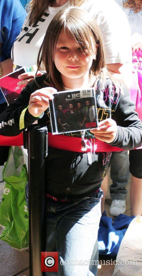 Fans Wait Eagerly Outside An Hmv Store In Peterborough Where Boyband Jls Will Be Meeting Fans 4