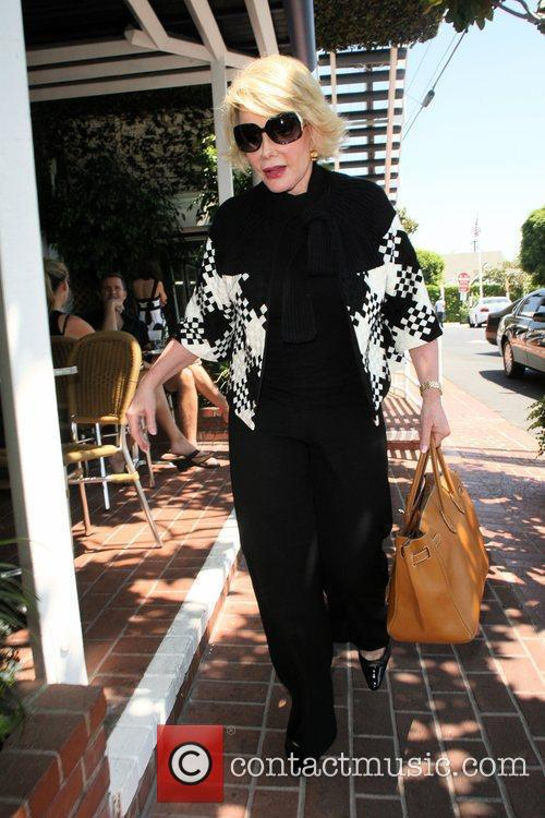Joan Rivers, carrying a tan Hermes handbag and arrives at Fred Segal for lunch 12
