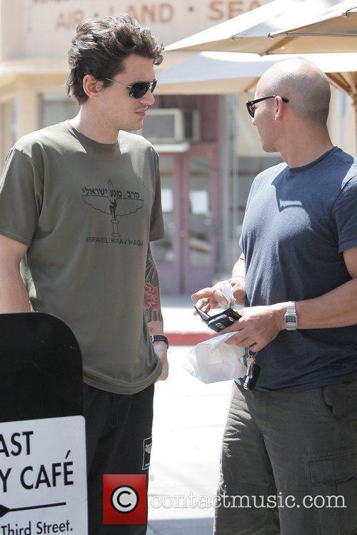 John Mayer pays for his valet parking after...