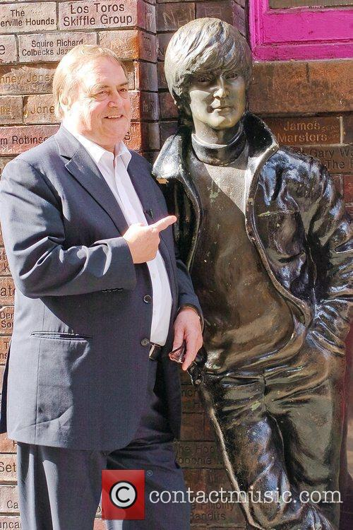 John Prescott poses with John Lennon's statue on...