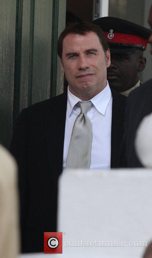 John Travolta  leaves the Supreme Court, after...