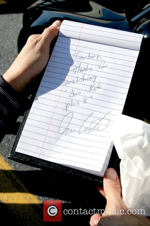 Jon Gosselin signs an autograph outside UPS where...