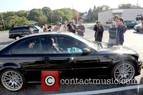 Jon Gosselin  gets into his luxury car...