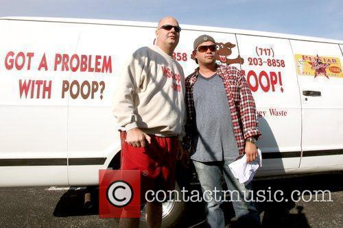 Jon Gosselin poses with 'Mr. Scoop' from a...