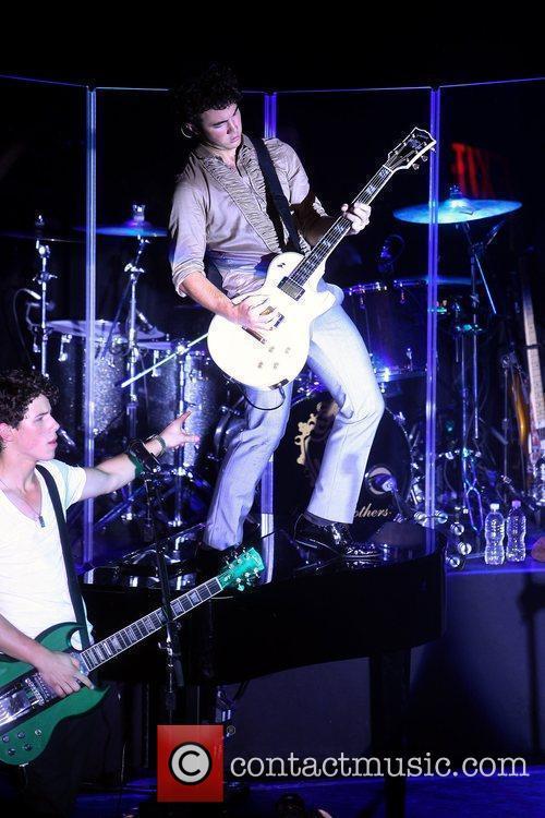 Nick Jonas and Kevin Jonas Jonas Brothers performing...