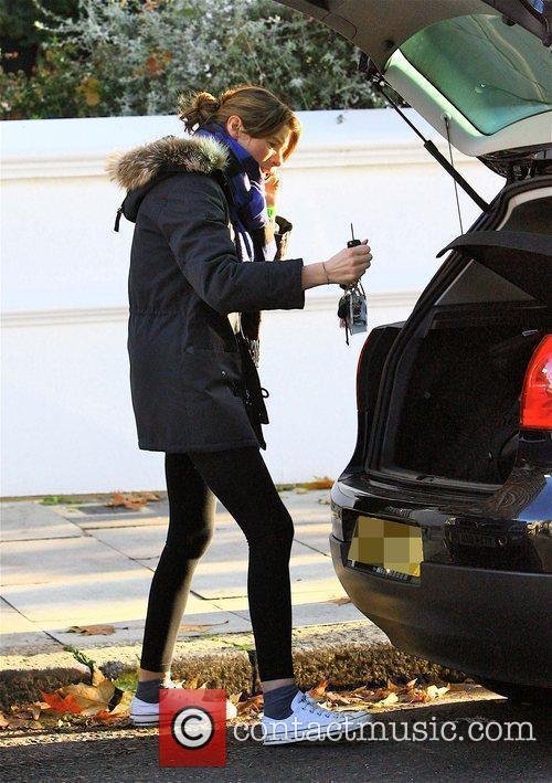 Jools Oliver loading her pram into her car...