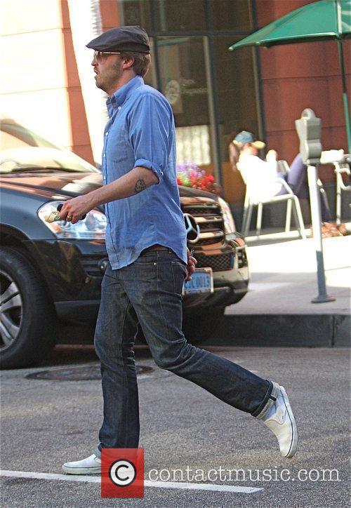Joshua Leonard walks off after eating at a...