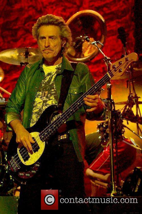 Bassist Ross Valory  performs with the band...
