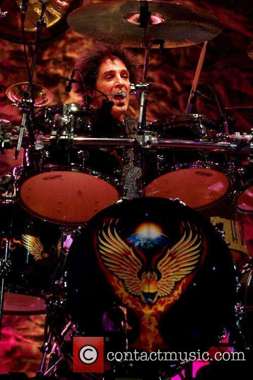 Drummer Deen Castronovo  performs with the band...