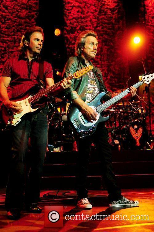 Jonathan Cain, Ross Valory performs with the band...