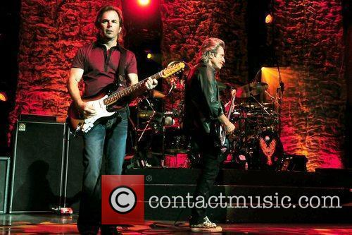 Keyboard Jonathan Cain and Bassist Ross Valory...